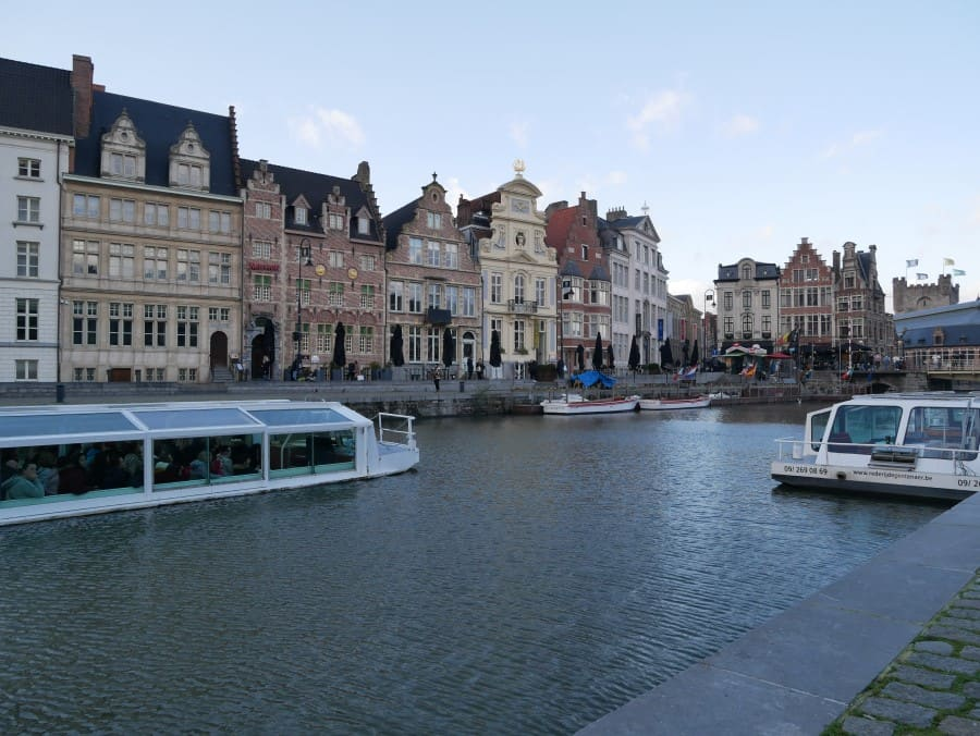 the boats on the main canal lined with old houses in Ghent