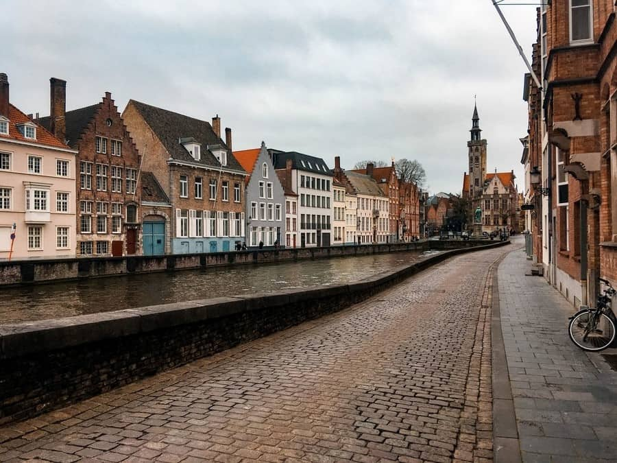 Medieval cobble stone streets of Bruges and the canal